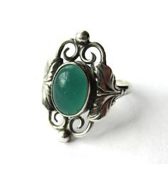 SOLD. Danish Art Nouveau style ring, apple green glass & sterling silver, Carl Ove Frydensberg, Scandinavian silver, vintage Denmark jewelry. https://www.etsy.com/uk/inglenookery/listing/532183745/danish-art-nouveau-style-ring-apple