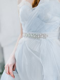 Dusty Blue Chiffon Bridesmaid Dress with a Crystal Sash   Rachel May Photography   A Rain Washed Garden Wedding in Pastel Blue and Fern Green to Kick Off Spring!