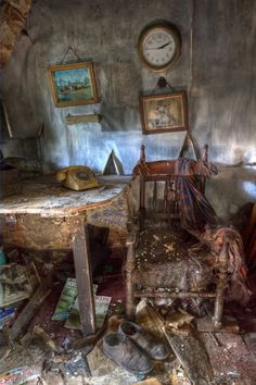 Someones valuable findings, now in ruin. Where did they go? Why did they leave everything, including hanging pictures?