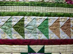 """""""Flying geese"""" piecing. The quilting really gives those geese wings."""