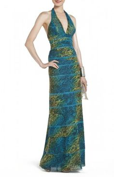 $186.00 Measures approximately 27.5″ from shoulder to hem. Concealed center back zipper with hook-and-eye closure. Sultry sophistication reigns when you enter the room in this stunning printed evening dress. Halter neck. Sleeveless. Classic fit. Allover snake print. Empire waist. Open back. Tulle: Nylon, Spandex. Dry Clean