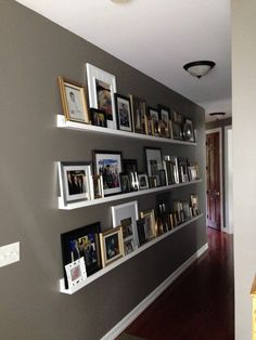 hallway with photo ledges, DIY picture ledges, ten dollar, $10 ledges, valspar seine, decorating a long hallway