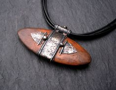Pendant | Sara from EarthenMe Designs.  Wood fired potter arrowhead and sterling silver