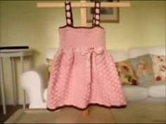 This video tutorial teaches you how to crochet this pink and brown baby dress.  Super cute!