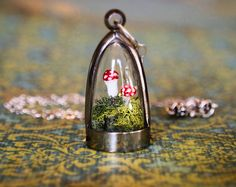 gorgeous and super adorable early morning etsy find: Terrarium Moss and Mushroom Dome Necklace by RenataandJonathan