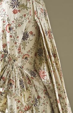LACMA Collections Online  France  Woman's Robe à la Française, circa 1770  Cotton plain weave, block-printed and dye-painted, with silk passementerie, Center back length: 61 in. (154.94 cm)  Purchased with funds provided by Suzanne A. Saperstein and Michael and Ellen Michelson, with additional funding from the Costume Council, the Edgerton Foundation, Gail and Gerald Oppenheimer, Maureen H. Shapiro, Grace Tsao, and Lenore and Richard Wayne (M.2007.211.718)  Costume and Textiles Department.