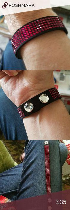 Nwt Swarovski bracelet w/red crystals Nwt Swarovski bracelet with red crystals and silver crystal button snaps for closing. Swarovski Jewelry Bracelets