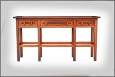 This beautiful table is well proportioned, with simple elegant lines that will grace any home. It can be used as a hall table, sofa table or an entry table. The table design is inspired by the furniture of brothers Charles and Henry Greene born around the 1860's. The Greene brothers architectural and furniture design peaked during the years 1902-1910. It was during this period that they created some of their finest works which includes the Gamble and Blacker residences in Pasadena, Cali...