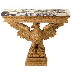 A George II giltwood marble-topped console table. | From a unique collection of antique and modern console tables at http://www.1stdibs.com/furniture/tables/console-tables/