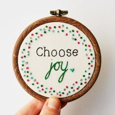 A miniature hoop art featuring the inspirational quote 'Choose joy' stitched by hand. Made by PixieCraft: