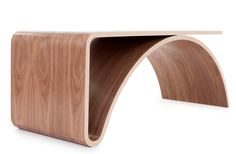"""Kaari in Finnish means """"arc"""" and clearly it's the perfect name for this table by Juhani Horelli. Initially inspired by the landscape of bridges, the form seemed to reveal itself through the Finnish an (Cool Furniture Design) Table Furniture, Cool Furniture, Modern Furniture, Furniture Design, Business Furniture, Outdoor Furniture, Furniture Removal, Plywood Furniture, Furniture Stores"""
