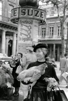 A woman named Marguerite walks a chicken through the streets and parks of Paris in 1956. Photos taken by LIFE photographer Nina Leen.