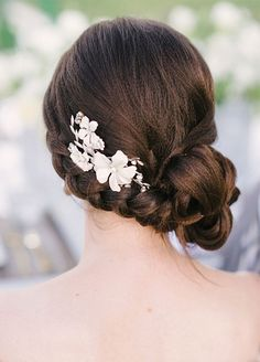 A side plait looks fabulous when paired with pearl flowers. Wedding Hairstyles, Hair Updos, Bridal Hair Accessories