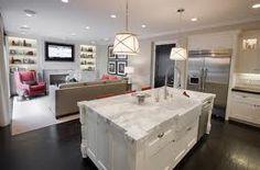 Farmhouse sink in white marble island