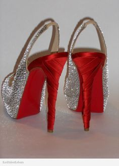 Check out these beautiful satin twisted Louboutin heels, strassed by Red Soles Reborn.
