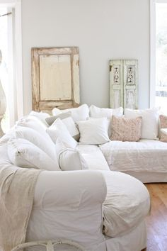 Slipcover sectional with plenty of pillows and throws