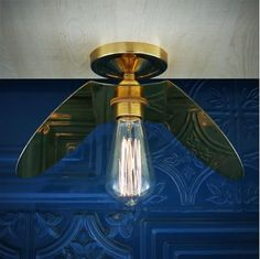 Designed to showcase the warmth of Edison-style bulbs, the Dodoma Semi Flush Fitting will provide  soft lighting into your decor. Ideal for small spaces, this vintage ceiling light can easily be fitted onto your low ceiling in your lounge, hallway or dining room It can be used as an accent piece over a home bar.