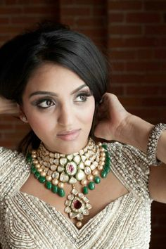 A very heavy kundan bandgala necklace with dark green polki giving it a more royal touch
