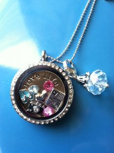 Origami Owl Living Locket  https://www.facebook.com/#!/pages/Origami-Owl-Custom-Jewelry-Katie-Paxton-Independent-Designer/228959250575793