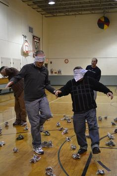 This was a new game we tried this year. A land mine field is set up in an open… This was a new game we tried this year. A land mine field is set up in an open space. (We taped wadded up balls of newspaper to the gym f… Youth Group Activities, Youth Games, Gym Games, Physical Education Games, Games For Teens, Camping Games, Youth Group Events, Funny Games For Groups, Field Day Activities