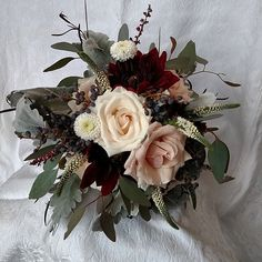 blush bridal bouquet with vendella and quicksand roses and black dahlias.