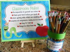 Mini classroom rules, placed on the teacher's desk.