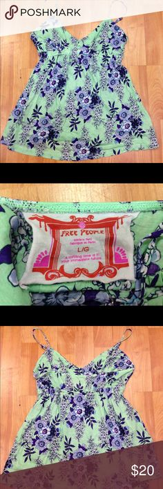 Free People Green Purple Floral Tank L Free People Green Purple Floral Tank L  Lightweight with adjustable straps.  Excellent used condition.  Elastic below the bust.  Bust portion is lined, portion below the elastic is not lined. Appears to run on the small side. #willscarlettbin15 top Free People Tops Tank Tops