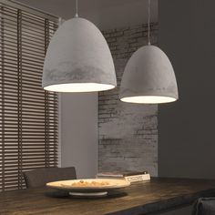 A pair of concrete pendant lamps.Concrete may not be the first material that comes to mind when you think of hanging lamps but they look stunning and push forwa Wall Fixtures, Light Fixtures, Street Lamp, Modern Chandelier, Hanging Lights, Interior Design Living Room, Pendant Lighting, Pendant Lamps, Ceiling Lights