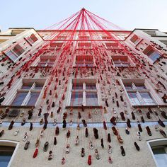 Chiharu Shiota - 'lebensspuren (traces of life)' at torstrasse 166, berlin, germany, 2008. Installation with 600 shoes and ca. 13.000 m thread. these shoes were collected from people who didn't want to use them anymore