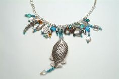 My homage to Mermaids. Vintage Swarovski crystals, glass beads, Greek ceramics, Bali silver, pearls, stones and a huge stunning hand hammered fish pendant. winnieandbelle Made in U.S.A.