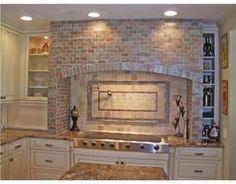 Hearth/Hood view of Tuscany inspired kitchen. Slate subway stone and tumbled  marble backsplash