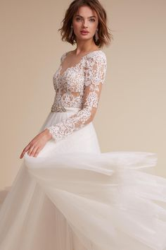 This bodysuit looks like the ideal blend of illusion and lace.  just need to pair with your favorite skirt, perhaps the BHLDN Sade skirt.  $500
