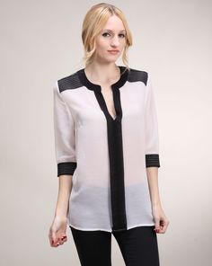 Megan Says: Black and white is a major theme for spring and this blouse combines the two shades in a sophisticated and chic way. This will add an instant dose of Parisian-chic to the simplest of outfits. Megan West, Duo Tone, Parisian Chic, Two By Two, Tunic Tops, Toe, Shades, Black And White, Blouse
