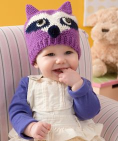 A cute pompom nose and stand-up ears are the perfect touches on this crochet animal hat.