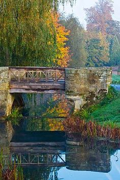 HEVER CASTLE, KENT, AUTUMN: BRIDGE OVER THE MOAT WITH REFLECTIONS