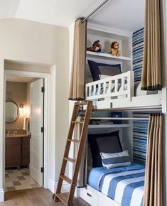 Fabulous bunk room with built-in bunks with storage drawers flanking hidden play area with kids seating illuminated by a Hicks Pendant. Bed Design, Home Bedroom, Bedroom Design, Bed, Loft Spaces, Built In Bunks, Bunk Beds Built In, Interior Design, Bed Curtains