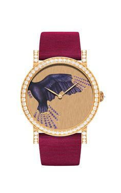 The Champlevé Grand Feu enamel dial on DeLaneau's Rondo Parrot Wing automatic watch in red gold is decorated amethysts and diamonds, with a diamond-set bezel, crown and buckle