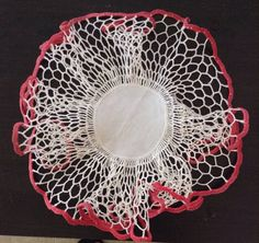Check out this item in my Etsy shop https://www.etsy.com/listing/526618125/really-ruffly-round-vintage-doily-with