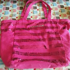 "Victoria's Secret Beach, Tote Bag PRICE REDUCTION Victoria's Secret tote bag with two Side Pockets. 18"" wide x 15"" tall. A couple sequins missing on the side that you carry against your body.  Not noticeable. Victoria's Secret Bags Totes"