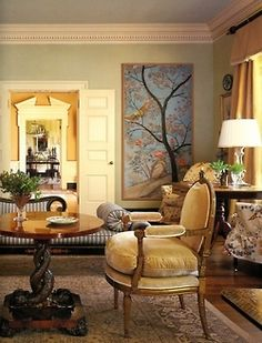 Highly traditional yet very warm - pure gorgeousity in this classic living room through foyer to dining room view. The velvet, the Chinoiserie panels, the double doors, the dentil mounldings, the peaked pediment over the dining room entryway.
