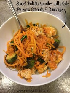 Spiralized Sweet Potato nodles with Roasted Brussels Sprouts, kale, garlic, red pepper flakes and Sausage. One pot meal- gluten free, healthy and total comfort food! SO yummy!