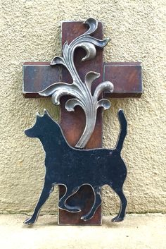A dog lover's cross.  By Birmingham metal artist Catherine Partain Shamblin, 2015