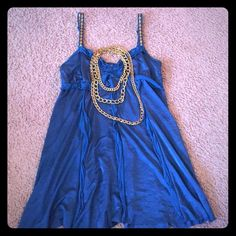 Free People Teal Ruffle Camisole Tank size medium Gently worn once - mint condition - gorgeous blue/ teal color - can be dressed up or down - I paired it with some chunky gold necklaces - would look great with black dress pants or jeans and pumps of course  Free People Tops Tank Tops
