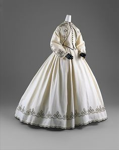 Day Dress  American, 1862–64  White cotton piqué with black soutache  The Metropolitan Museum of Art, New York, Gift of Chauncey Stillman, 1960 (C.I.60.6.11a, b)