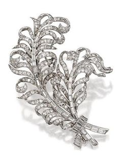 DIAMOND FEATHER BROOCH, FRENCH, CIRCA 1940. The pair of curling feathers tied at the stems with a ribbon, set with 297 single-cut and 52 baguette diamonds weighing approximately 10.25 carats, mounted in platinum, French assay marks.