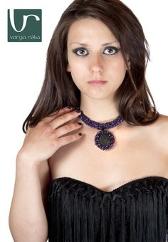 Lilac cylindrical necklace crocheted with a mixture of Czech Preciosa beads, with round leather medal.
