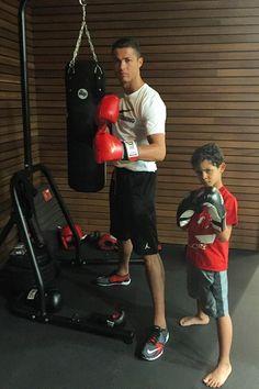Cristiano Ronaldo wearing  Jordan Dominate 2.0 Solid Shorts, Nike Cr7 Madeira Edition Free Trainer 3.0 Sneakers, Everlast Boxing Gloves, Nike Swoosh Training T-Shirt