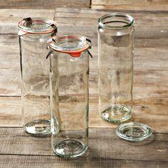 """Weck Cylindrical Jars, 20oz, Set of 6 Each clear glass jar features a glass lid with rubber ring and two rustproof stainless-steel clamps for creating an airtight seal you can check at a glance. Wide-mouth shape is easy to fill. Seal is easy to check at a glance: the pull-tab on the rubber ring should face downward. Embossed with the Weck strawberry logo. Dishwasher safe. 20.2-oz. cap.; 8 1/4"""" high, 2 1/2"""" opening. Set includes 6 jars, 6 lids, 6 rubber rings and 12 clamps.  $29.95"""