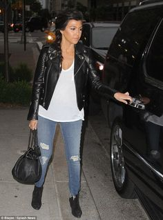 Kourtney Kardashian wore a black leather motorcycle jacket and ripped jeans as she headed out on her date with Scott Disick in NYC