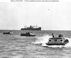 US Marine Corps LVT(1) amphibian tractors move toward the beach on Guadalcanal Island. This view was probably taken during the 7-9 August 1942 initial landings on Guadalcanal.